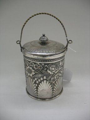 James W. Tufts (1875-ca. 1914). Biscuit Jar with Lid, 1875-1885. Silverplate, a, with handle: 9 3/4 x 5 1/4 x 4 9/16 in. (24.8 x 13.3 x 11.6 cm). Brooklyn Museum, Gift of Sarah Eigen, 2012.60.5a-b. Creative Commons-BY