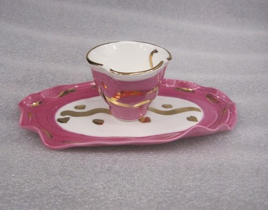 Betty Woodman (American, born 1930). Study for Cup and Saucer, 2012. Porcelain (pink), a. cup: 2 1/4 x 2 7/8 in. (5.7 x 7.3 cm). Brooklyn Museum, Gift of Charles Woodman, 2013.19.2a-b