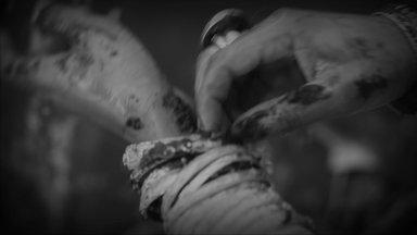 Wangechi Mutu (Kenyan, born 1972). Eat Cake, 2012. Video installation, beta master tape and two viewing copy Blu-ray discs, wooden pallets Brooklyn Museum, Alfred T. White Fund, 2014.9. © Wangechi Mutu