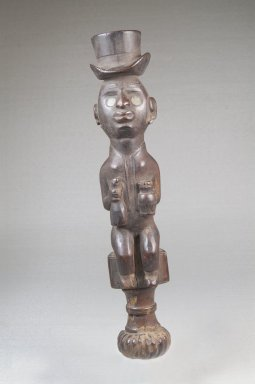 Kongo (Vili subgroup). Top of Whistle (Nsiba), late 19th or early 20th century. Wood, glass, lead, applied materials, 9 x 1 1/2 x 1 1/2 in. (22.9 x 3.8 x 3.8 cm). Brooklyn Museum, Museum Expedition 1922, Robert B. Woodward Memorial Fund, 22.104. Creative Commons-BY