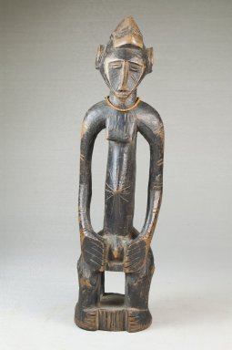 Senufo. Figure of a Seated Male, late 19th or early 20th century. Wood, glass beads, 10 3/4 x 3 x 2 3/4 in. (27.3 x 7.6 x 7 cm). Brooklyn Museum, Museum Expedition 1922, Robert B. Woodward Memorial Fund, 22.1093. Creative Commons-BY