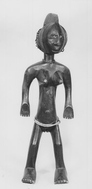 Bamana. Figure of a Standing Female (Nyeleni), late 19th or early 20th century. Wood, metal, shells, 20 3/4 x 6 1/2 x 7in. (52.7 x 16.5 x 17.8cm). Brooklyn Museum, Museum Expedition 1922, Robert B. Woodward Memorial Fund, 22.1094. Creative Commons-BY