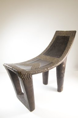 Ngombe. Chief's Seat (Ekele), late 19th century. Wood, copper alloy, applied material, 20 3/4 x 10 1/2 x 23 1/2 in. (52.7 x 26.7 x 59.7 cm). Brooklyn Museum, Museum Expedition 1922, Robert B. Woodward Memorial Fund, 22.1109. Creative Commons-BY