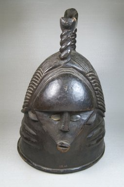 Mende. Janus Faced (Ndoli jowei) Mask of the Sande Society, late 19th century. Wood, glass, 15 3/4 x 11 x 12 in. (40 x 27.9 x 30.5 cm). Brooklyn Museum, Museum Expedition 1922, Robert B. Woodward Memorial Fund, 22.1113. Creative Commons-BY