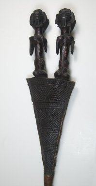 Luba. Staff of Office, late 19th or early 20th century. Wood, sheet copper alloy, iron, oil, 51 3/8 x 4 1/4 x 2 in. (130.5 x 10.8 x 5.1 cm). Brooklyn Museum, Brooklyn Museum Collection, 22.1133. Creative Commons-BY