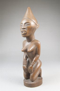 Possibly Kongo (Vili subgroup). Kneeling Female Figure, late 19th or early 20th century. Wood, applied materials, 8 1/2 x 2 3/8 in. (21.6 x 6 cm). Brooklyn Museum, Museum Expedition 1922, Robert B. Woodward Memorial Fund, 22.1140. Creative Commons-BY