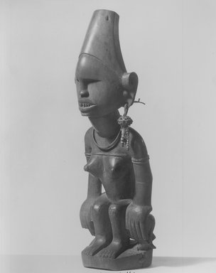 Kongo (Yombe subgroup). Female Figure Seated on Animal, 19th century. Wood, seed pod, plastic beads, copper alloy, 12 x 4 x 3 3/4in. (30.5 x 10.2 x 9.5cm). Brooklyn Museum, Museum Expedition 1922, Robert B. Woodward Memorial Fund, 22.1141. Creative Commons-BY