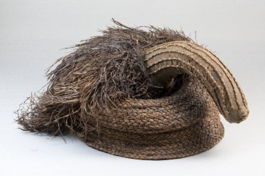 Possibly Kongo. Cap, late 19th century. Raffia, cloth, height: 4 3/4 in. (12 cm); diameter: 7 1/2 in. (19.1 cm). Brooklyn Museum, Museum Expedition 1922, Robert B. Woodward Memorial Fund, 22.1284. Creative Commons-BY