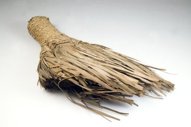 Brush, late 19th-early 20th century. Vegetal fiber, 13 x 9 3/4 x 2 in. (33 x 24.8 x 5.1 cm). Brooklyn Museum, Museum Expedition 1922, Robert B. Woodward Memorial Fund, 22.1332. Creative Commons-BY