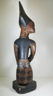 Possibly Kongo. Figure of Man with Knife, 19th or 20th century. Wood, pigment, ceramic, 38 x 10 3/4 in. (96.5 x 27.3 cm). Brooklyn Museum, Museum Expedition 1922, Robert B. Woodward Memorial Fund, 22.1410. Creative Commons-BY