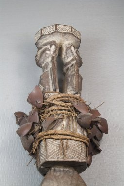 Kongo (Yombe subgroup). Rattle with Male Figure, before 1922. Wood, fiber, shells, 11 7/16 x 2 3/4 in. (29 x 7 cm). Brooklyn Museum, Museum Expedition 1922, Robert B. Woodward Memorial Fund, 22.1422. Creative Commons-BY