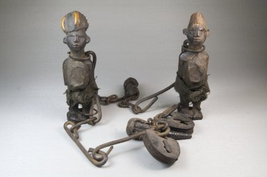 Kongo (Sundi subgroup). Chain with Figures, late 19th or early 20th century. Iron, wood, fiber, glass mirror, bird beaks, duiker horns, cloth, medicinal material, 21 1/2in. (54.6cm). Brooklyn Museum, Museum Expedition 1922, Robert B. Woodward Memorial Fund, 22.1431. Creative Commons-BY