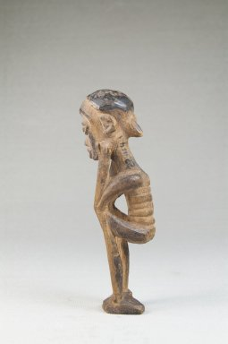 Lulua. Figure of a Squatting Male, early 20th century. Wood, 4 1/2 x 1 1/4 x 1 1/4 in. (11.4 x 3.2 x 3.2 cm). Brooklyn Museum, Museum Expedition 1922, Robert B. Woodward Memorial Fund, 22.1448. Creative Commons-BY