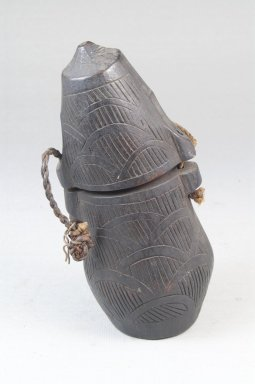 Kongo. Powder Box (Tutukipfula), late 19th-early 20th centuries. Wood, cord, height: 5 1/4 in. (13.3 cm); diameter: 2 1/2 in. (6.4 cm). Brooklyn Museum, Museum Expedition 1922, Robert B. Woodward Memorial Fund, 22.144. Creative Commons-BY