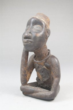 Kongo (Vili subgroup). Seated Male Figure, late 19th or early 20th century. Wood, shell, metal, resin, pigment, 5 x 2 1/8 x 2 3/4 in. (12.5 x 5.5 x 7.0 cm). Brooklyn Museum, Museum Expedition 1922, Robert B. Woodward Memorial Fund, 22.1450. Creative Commons-BY