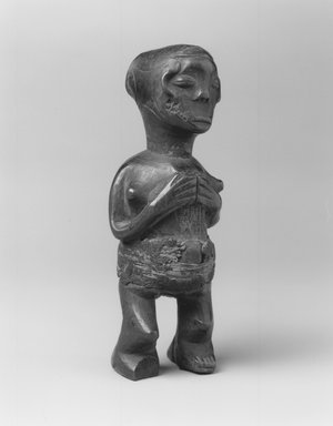 Mbala. Standing Female Figure, 19th or early 20th century. Wood, fiber, organic materials, 6 7/8 x 2 1/4 x 2in. (17.5 x 5.7 x 5.1cm). Brooklyn Museum, Museum Expedition 1922, Robert B. Woodward Memorial Fund, 22.1451. Creative Commons-BY