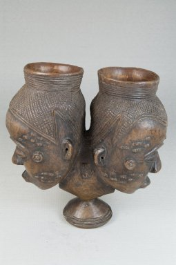 Kuba (Bushoong subgroup). Janus-Faced Goblet (Mbwoongntey), early 20th century. Wood, 5 3/4 x 5 1/2 in. (14.5 x 14.0 cm). Brooklyn Museum, Museum Expedition 1922, Robert B. Woodward Memorial Fund, 22.1488. Creative Commons-BY
