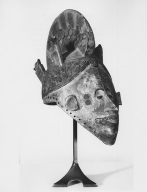 Nupe. Maiden Spirit Mask (Agbogho Mmuo), 19th century. Wood, cloth, fiber, 16 1/2 x 7 1/4 x 11 in. (41.9 x 18.4 x 27.9 cm). Brooklyn Museum, Museum Expedition 1922, Robert B. Woodward Memorial Fund, 22.1592. Creative Commons-BY