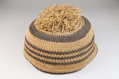 Kongo. Basketry Cap, late 19th century. Raffia vegetal fiber, height: 2 3/4 in. (7 cm); diameter: 6 1/4 in. (15.9 cm). Brooklyn Museum, Brooklyn Museum Collection, 22.1606. Creative Commons-BY