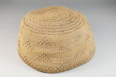 Kongo. Basketry Cap, late 19th or early 20th century. Raffia, height: 3 1/8 in. (7.9 cm); diameter: 6 in. (15.2 cm). Brooklyn Museum, Brooklyn Museum Collection, 22.1626. Creative Commons-BY