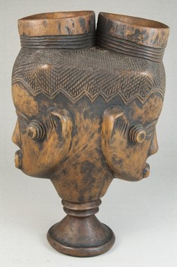 Kuba. Goblet with Double Head (Mbwoongntey), early 20th century. Wood, 8 9/16 x 5 5/16 in. (21.8 x 13.5 cm). Brooklyn Museum, Museum Expedition 1922, Robert B. Woodward Memorial Fund, 22.162. Creative Commons-BY