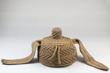 Possibly Kuba (Nkutshu subgroup). Cap With Topknot and Side Extensions, late 19th or early 20th century. Raffia thread, 5 15/16 x 8 7/8 x 8 7/8 in. (15.1 x 22.5 x 22.5 cm). Brooklyn Museum, Museum Expedition 1922, Robert B. Woodward Memorial Fund, 22.1641. Creative Commons-BY