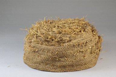 Possibly Kongo. Basketry Cap, late 19th century. Fiber, raffia, height: 3 1/8 in. (7.9 cm); diameter: 6 5/16 in. (16 cm). Brooklyn Museum, Museum Expedition 1922, Robert B. Woodward Memorial Fund, 22.1644. Creative Commons-BY