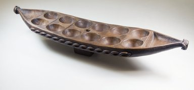 Possibly Bullom. Mancala Game Board, late 19th century. Wood, 25 3/4 x 5 1/2 x 6 1/2 in.  (65.4 x 14 x 16.5 cm). Brooklyn Museum, Museum Expedition 1922, Robert B. Woodward Memorial Fund, 22.213. Creative Commons-BY