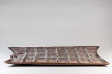 Mancala Game Board, late 19th century. Wood, 1/2 x 19 x 10 in. (1.3 x 48.3 x 25.4 cm). Brooklyn Museum, Museum Expedition 1922, Robert B. Woodward Memorial Fund, 22.217. Creative Commons-BY