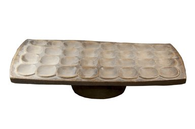 Mancala Game Board, late 19th century. Wood, 5 1/8 x 24 3/4 x 11 in. (13 x 62.9 x 27.9 cm). Brooklyn Museum, Museum Expedition 1922, Robert B. Woodward Memorial Fund, 22.220. Creative Commons-BY