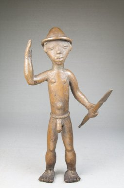 Bwayen (We, flourished 1920s-1930s). Male Nude with Hat Carrying a Spear, early 20th century. Copper alloy, 9 1/2 x 5 x 4 1/2 in. (24.1 x 12.7 x 11.4 cm). Brooklyn Museum, Museum Expedition 1922, Robert B. Woodward Memorial Fund, 22.222. Creative Commons-BY