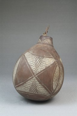 Calabash, before 1922. Calabash, clay, height: 4 1/2 in. (11.5 cm); diameter: 3 9/16 in. (9 cm). Brooklyn Museum, Museum Expedition 1922, Robert B. Woodward Memorial Fund, 22.374. Creative Commons-BY