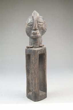 Yaka. Figure with Hollow Rectangular Body, 19th century. Wood, iron, 5 1/2 x 1 1/4 x 2 in. (14.0 x 3.2 x 5.0 cm). Brooklyn Museum, Museum Expedition 1922, Robert B. Woodward Memorial Fund, 22.475. Creative Commons-BY