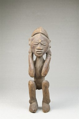 Lulua. Figure of a Man Squatting, late 19th or early 20th century. Wood, 6 1/4 x 1 3/4 x 2 in. (15.9 x 4.4 x 5.1 cm). Brooklyn Museum, Museum Expedition 1922, Robert B. Woodward Memorial Fund, 22.483. Creative Commons-BY