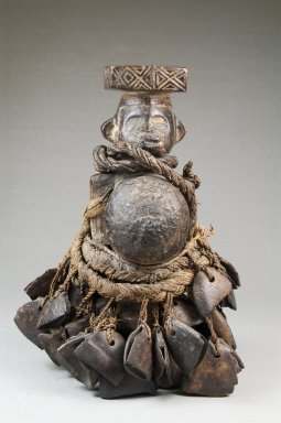 Kongo (Yombe subgroup). Standing Figure with Seed Pods and Beaks of Hornbill, late 19th or early 20th century. Wood, beaks of hornbills, seedpods, string, 6 1/2 x 4 x 3 1/2 in. (16.5 x 10.2 x 8.9 cm). Brooklyn Museum, Museum Expedition 1922, Robert B. Woodward Memorial Fund, 22.497. Creative Commons-BY