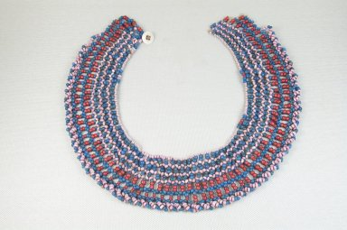 Xhosa. Collar (Icangci or Ingqosha), early 20th century. Glass beads, natural fiber, button, 20 3/4 x 2 in. (52.7 x 5.1 cm). Brooklyn Museum, Museum Expedition 1922, Robert B. Woodward Memorial Fund, 22.592. Creative Commons-BY
