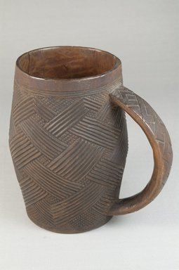 Kuba (Bushoong subgroup). Cup, early 20th century. Wood, height: 5 5/16 in. (13.5 cm); diameter: 3 1/16 in. (7.8 cm). Brooklyn Museum, Museum Expedition 1922, Robert B. Woodward Memorial Fund, 22.799. Creative Commons-BY