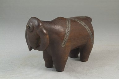 Possibly Zulu. Snuff Container in Form of a Buffalo, 19th century. Wood, metal, 2 1/2 x 6 1/4 x 1 1/2 in.  (6.4 x 15.9 x 3.8 cm). Brooklyn Museum, Museum Expedition 1922, Robert B. Woodward Memorial Fund, 22.809. Creative Commons-BY