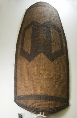 Banda, Mbugbu sub-group. Shield, late 19th century. Fiber, wood (handle), 51 3/16 x 17 11/16 in. (130 x 45 cm). Brooklyn Museum, Museum Expedition 1922, Robert B. Woodward Memorial Fund, 22.847. Creative Commons-BY