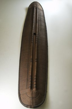 Konda, Mongo. Shield, late 19th century. Fiber, wood, 53 1/8 x 9 7/16 in. (135 x 24 cm). Brooklyn Museum, Museum Expedition 1922, Robert B. Woodward Memorial Fund, 22.853. Creative Commons-BY