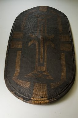Zande. Shield, late 19th century. Fiber, wood., 43 11/16 x 20 1/16 in. (111 x 51 cm). Brooklyn Museum, Museum Expedition 1922, Robert B. Woodward Memorial Fund, 22.857. Creative Commons-BY