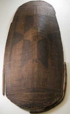 Banda, Mbugbu sub-group. Shield, 19th century. Fiber, wood, 45 x 15 in. (114.3 x 38.1 cm). Brooklyn Museum, Museum Expedition 1922, Robert B. Woodward Memorial Fund, 22.864. Creative Commons-BY