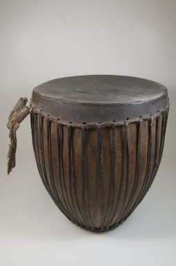 Drum, late 19th or early 20th century. Wood, hide, leather, 18 1/2 x 16 1/8 x 16 1/8 in. (47 x 41 x 41 cm). Brooklyn Museum, Museum Expedition 1922, Robert B. Woodward Memorial Fund, 22.887. Creative Commons-BY