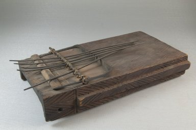 Plucked Idiophone (Sanza), late 19th or early 20th century. Engraved wood, metal, 2 1/2 x 9 x 5 in. (6.4 x 22.9 x 12.7 cm). Brooklyn Museum, Museum Expedition 1922, Robert B. Woodward Memorial Fund, 22.891. Creative Commons-BY