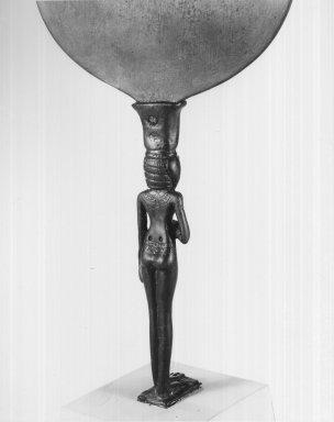 Mirror with Handle in the Form of Woman, ca. 1352-1336 B.C.E. Bronze, 6 1/8 x 5 9/16 x 1 in. (15.5 x 14.2 x 2.6 cm) . Brooklyn Museum, Gift of the Egypt Exploration Society, 25.886.1. Creative Commons-BY