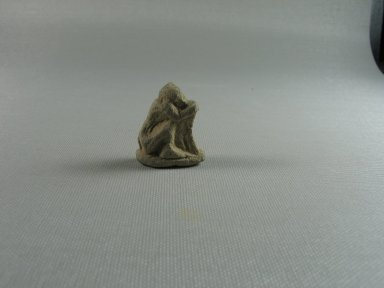 Small Figure of a Seated Monkey. Limestone, 1 3/8 x 9/16 x 1 1/8 in. (3.5 x 1.4 x 2.9 cm). Brooklyn Museum, Gift of the Egypt Exploration Society, 25.886.9. Creative Commons-BY