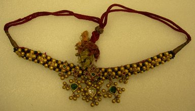 Necklace, 19th century. gold beads, glass (?), red cords, L. overall 15 in; central section 9 in. Brooklyn Museum, 25588. Creative Commons-BY