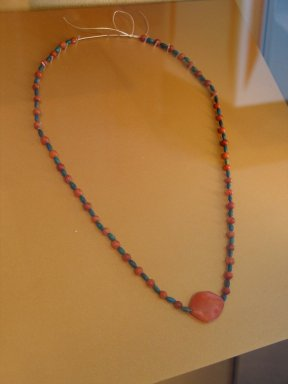 Necklace, ca. 1938-1759 B.C.E. Carnelian, faience, 23 1/4 in. (59 cm). Brooklyn Museum, Gift of the Egypt Exploration Society , 26.161. Creative Commons-BY