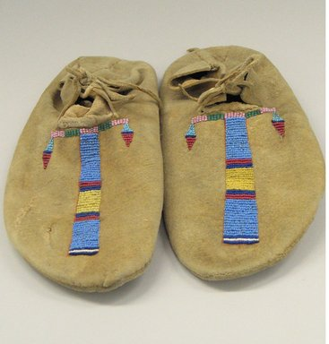 Cheyenne (Native American). Pair of Moccasins, Part of War Outfit, late 19th-early 20th century. Hide, beads, pigment, 10 13/16 x 4 3/4 in. (27.5 x 12.1 cm). Brooklyn Museum, Robert B. Woodward Memorial Fund, 26.794a-b. Creative Commons-BY