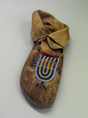 Blackfoot (probably) (Native American). Moccasin with Blue,Yellow, White and Red Beading, 1880-1890. Hide, beads, pigment., 6 11/16 x 4 5/16 x 11 7/16in. (17 x 11 x 29cm). Brooklyn Museum, Robert B. Woodward Memorial Fund, 26.795. Creative Commons-BY